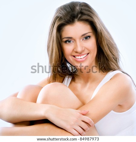 Beautiful young woman. Isolated on blue background