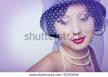 Beautiful young woman. Isolated over lilac background
