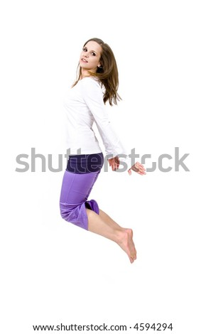 Beautiful young woman jumping - white background