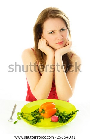 beautiful young woman keeping a diet and showing her disgust to vegetables - stock photo