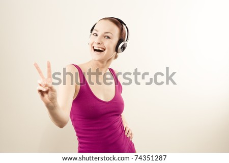 Beautiful young woman listening to the music - stock photo