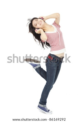 beautiful young woman listens to music and dances