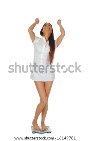 Beautiful young woman looking really excited about her weight loss and raising her arms in the air, isolated on white