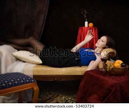 Beautiful young woman lying in the sofa
