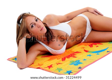 Beautiful Young Woman Lying On A Beach Towel Wearing A White Bikini, Isolated Over White