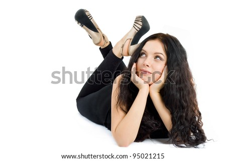 beautiful young woman lying on the floor and looking up