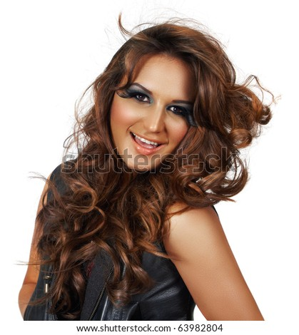 beautiful young woman of mixed ethnicity with long curly hair and party make-up - easy to extend for copy space.