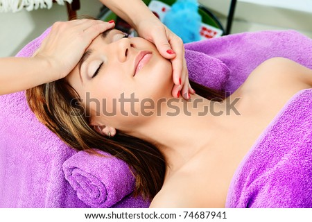 Beautiful young woman on a massage at a salon. Beauty, healthcare.