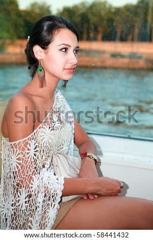 Beautiful young woman on a tour boat in the River Seine in Paris, France.