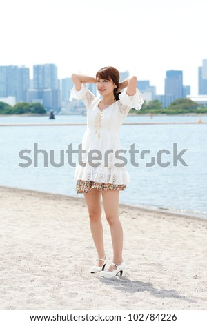 Beautiful young woman on beach summer holiday. Portrait of asian - stock photo