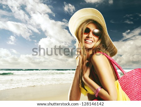 Beautiful young woman on the beach