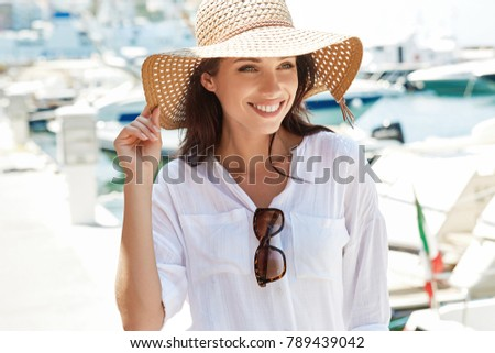 Beautiful young woman on vacation. Summer concept.  #789439042
