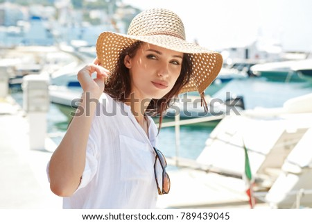 Beautiful young woman on vacation. Summer concept.  #789439045