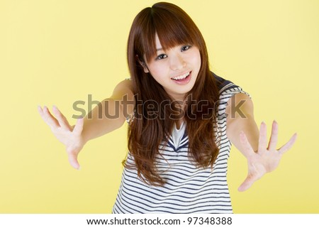 Beautiful young woman on yellow background. Portrait of asian woman.
