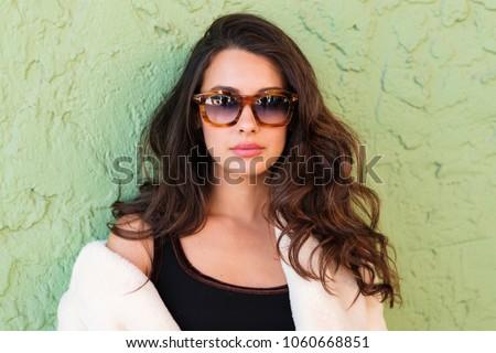 Beautiful young woman outdoor fashion portrait wearing sunglasses. #1060668851