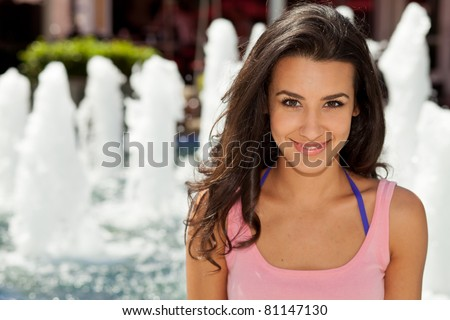 Beautiful young woman outdoor in Miami Beach Lincoln Road Mall.
