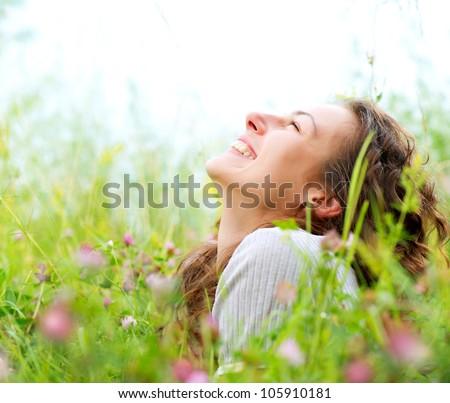 Beautiful Young Woman Outdoors. Enjoy Nature. Meadow - stock photo