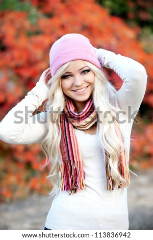 Beautiful young woman outdoors in autumn