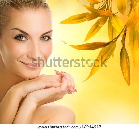 Beautiful young woman over abstract autumn background