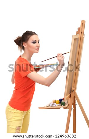 beautiful young woman painter at work, isolated on white