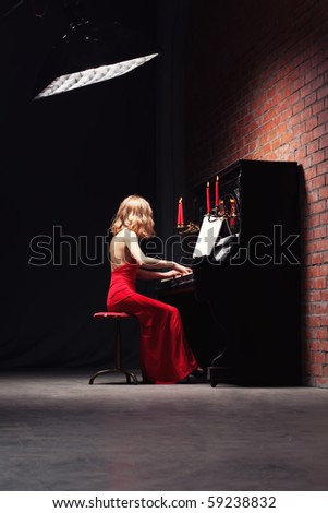 beautiful young woman playing the piano