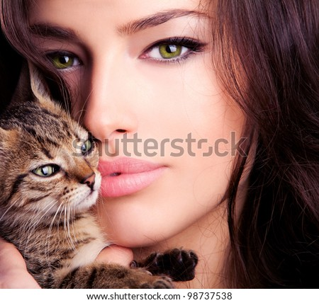 beautiful young woman portrait holding kitten, close up