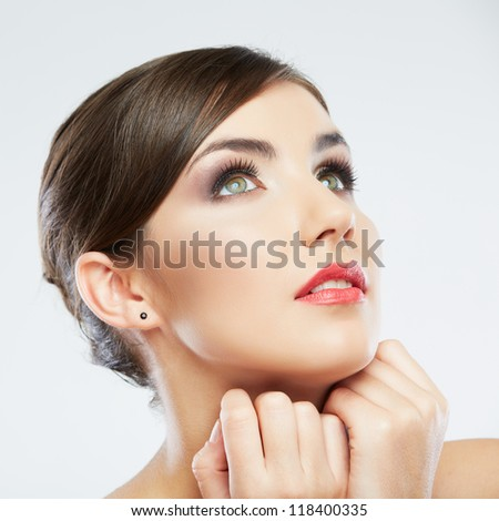 Beautiful young woman portrait  isolated on studio background. Close up face. - stock photo