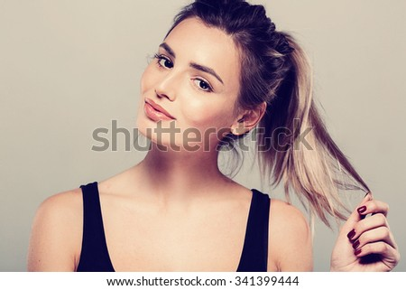 Beautiful young woman portrait smiling posing attractive blond  #341399444