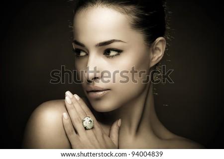 beautiful young woman portrait, studio dark