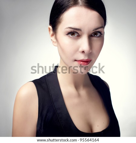beautiful young woman portrait with brunette hair , studio shot