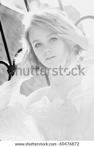 Beautiful young woman posing outdoors in pink dress #60476872