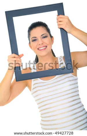 beautiful young woman posing through empty frame