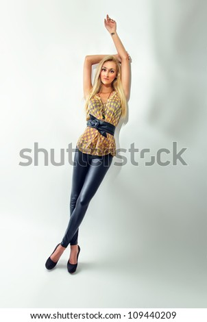 Beautiful young woman posing, vogue style photo