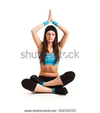 Beautiful young woman practicing meditation