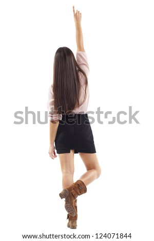 beautiful young woman raises her arm back