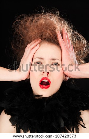 Beautiful young woman raising her hands to her head in horror as she bleeds from her nose