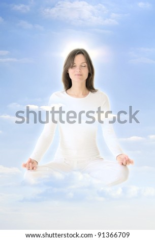 Beautiful young woman raising in the sky, meditating in the clouds