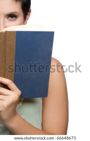 Beautiful young woman reading book - stock photo
