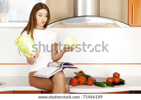 beautiful young woman ready to prepare salad
