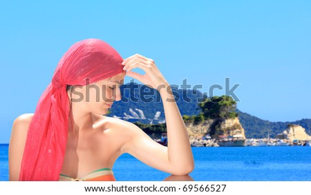 Beautiful young woman relaxing by the beach in Greece - stock photo