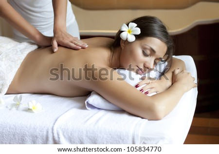 beautiful young woman relaxing in a spa situation