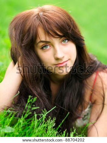 beautiful young woman relaxing in spring sunny park