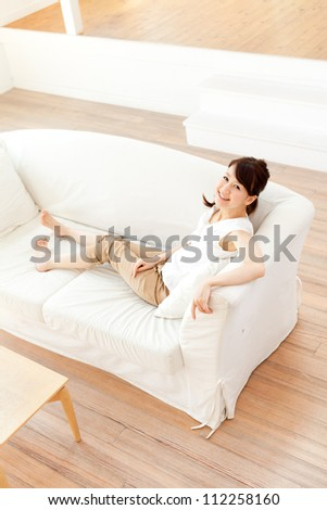 Beautiful young woman relaxing in the room. Portrait of asian.
