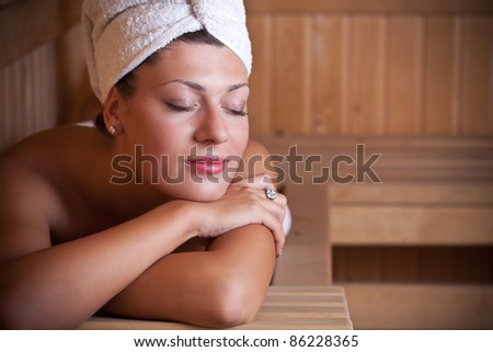 Beautiful young woman relaxing in the sauna