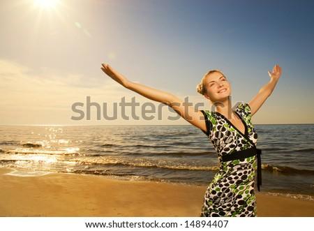Beautiful young woman relaxing near the ocean - stock photo
