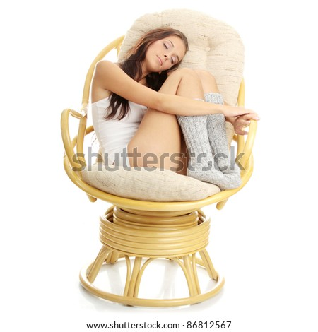 Beautiful young woman resting in armchair. Isolated on white background