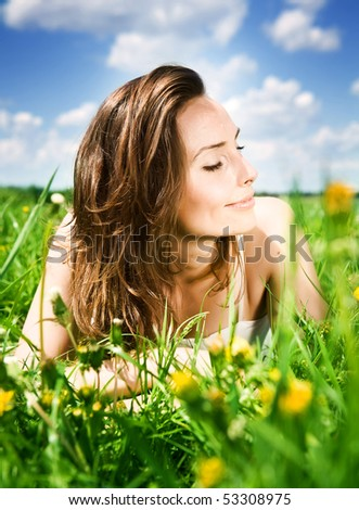 Beautiful Young Woman resting in the park