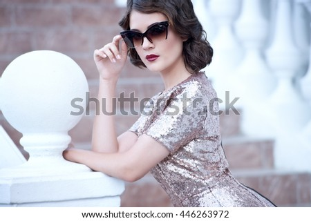 Beautiful young woman retro style outdoor
