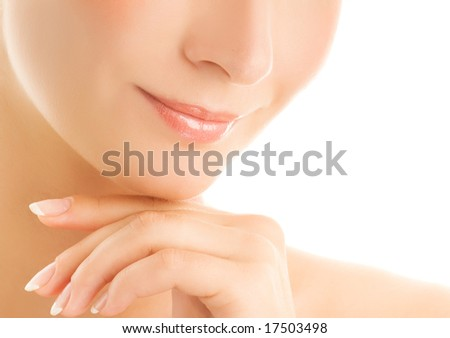 Beautiful young woman's face fragment. Isolated on white background