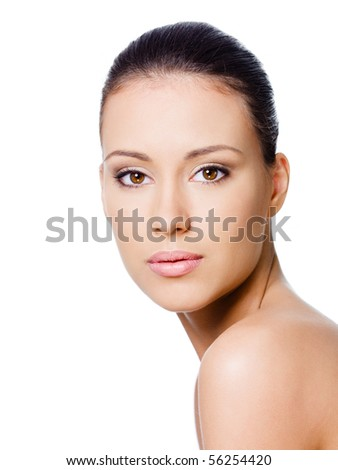 Beautiful young woman's face with healthy clean skin